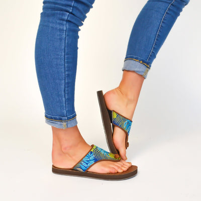 Women's Artwalk Embroidered Flip Sandals in blue jungle on foot on white backdrop