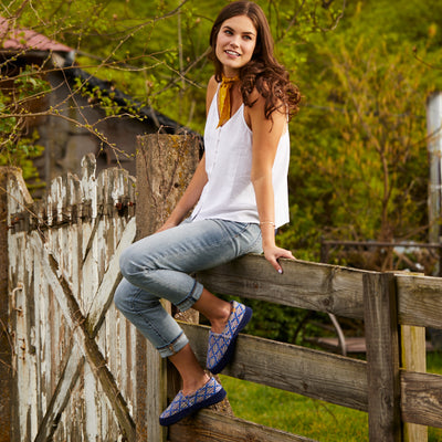Women's Summerweight Moccasins in Navy Sitting on a Fence