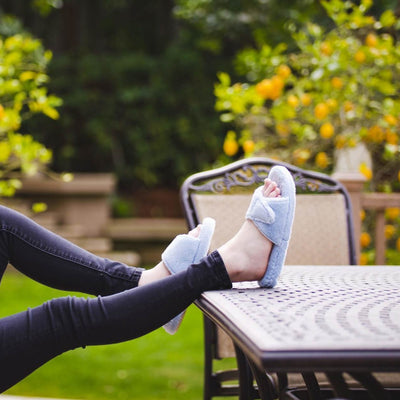 Women's Spa Slide Slippers in Powder Blue on model with feet up on outdoor patio table