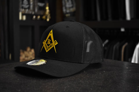 Kingsmen Secret Symbol | Retro trucker cap - Yellow on Black