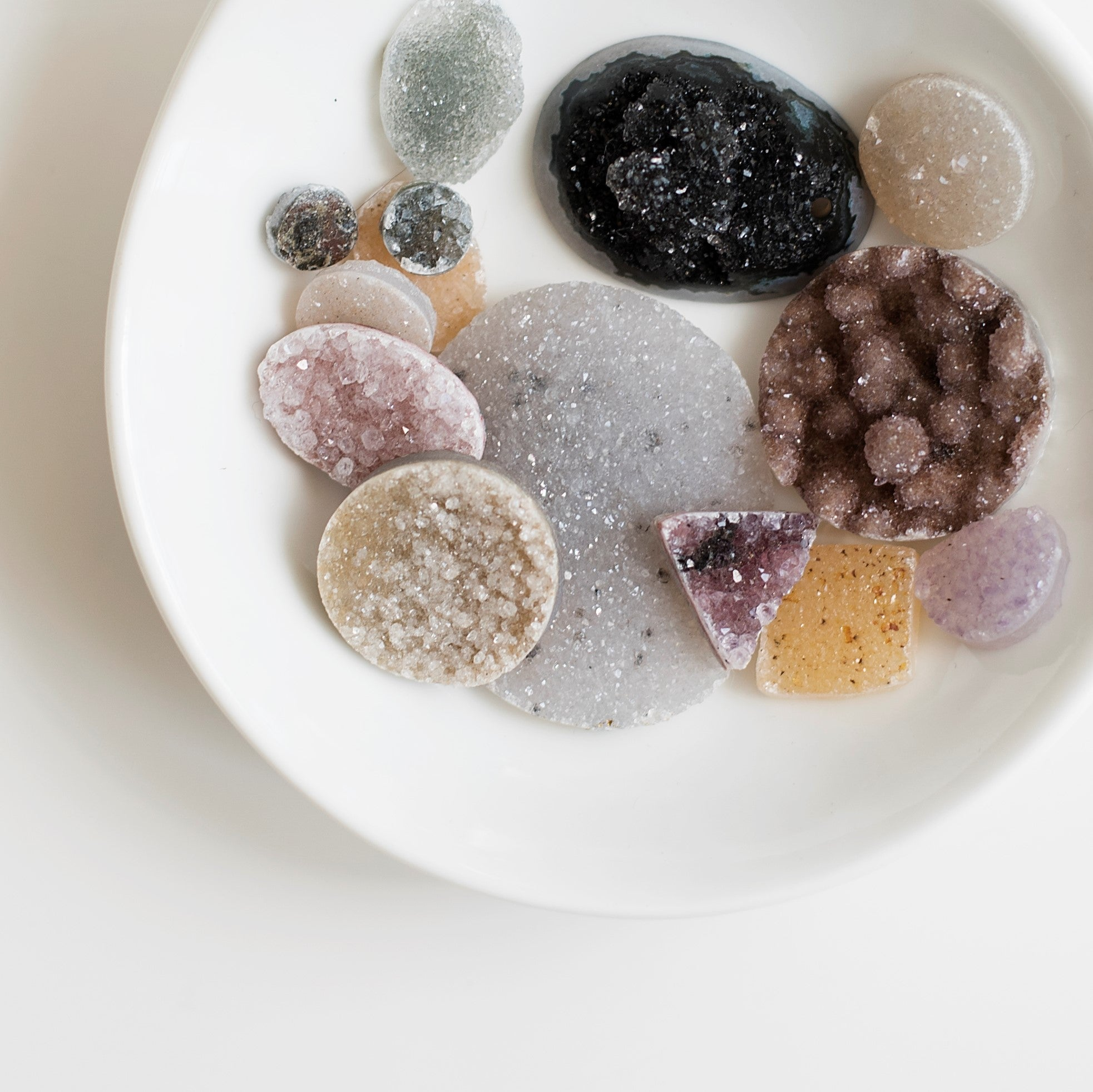 Formed over millennia, the tiny, glittering crystals that make up druzy grow from mineral-rich water trapped in pockets of rock. The resulting plates of druzy occur naturally in an incredible range of colors and sizes, and are often cut for jewelry or har