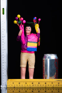 Balloon Seller Clay Figure by Alfonso Soteno rulers