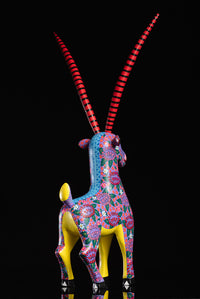 Gazelle alebrije painted with flowers Oaxacan wood carving