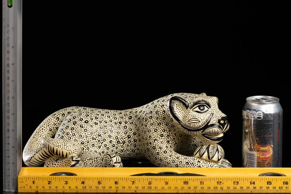 Lying down Mexican Clay Jaguar Beige Black spots with rulers