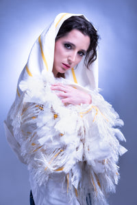 Woman wearing a Mexican White shawl with yellow feathers Indigenous folk art