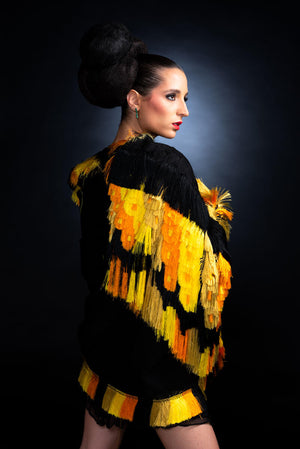 Woman Wearing Black & Yellow Cape  Mexican Indigenous Textile Side View