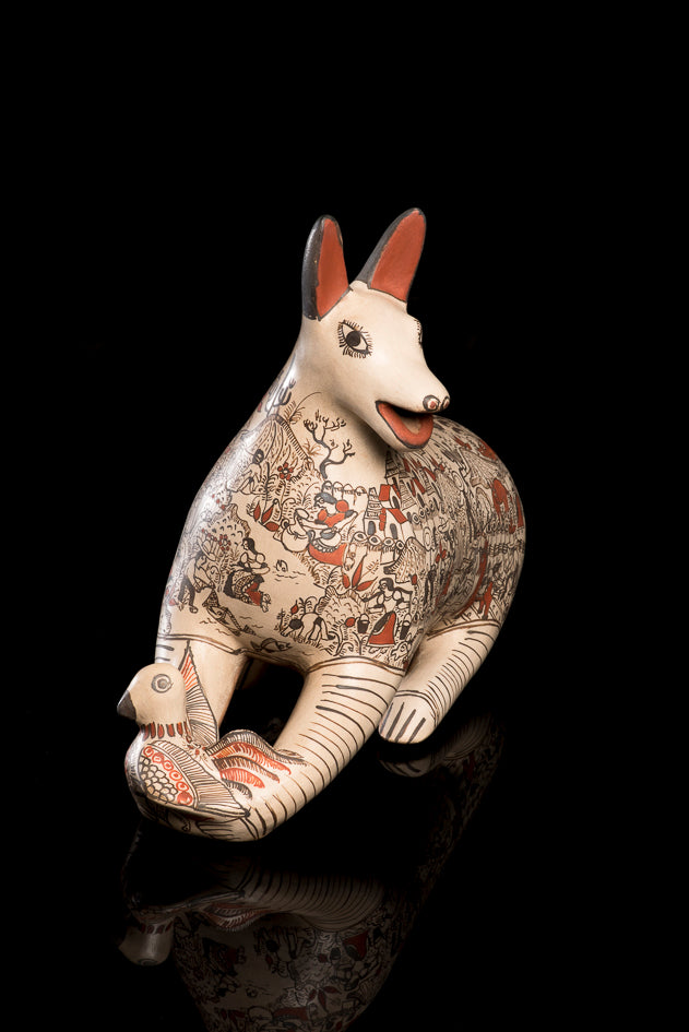 Clay coyote with dove sculpture from Guerrero Mexico