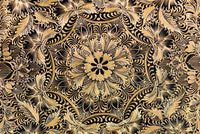 Detail of central floral geometric decoration of Gold Outlined Dish Lacquerware with geometric patterns. Folk Art from Patzcuaro.