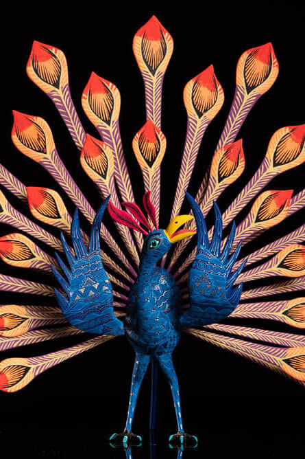 Peacock alebrije Oaxacan wood carving zoom