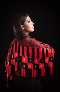 Woman wearing black & red Mexican Indigenous Textile with fringe
