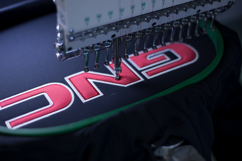 Custom Digital Applique Embroidered Corporate Logo on a Custom Sweatshirt