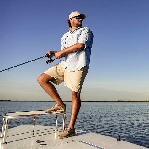 Add your company logo to custom Columbia fishing shirts for men with Merchology!