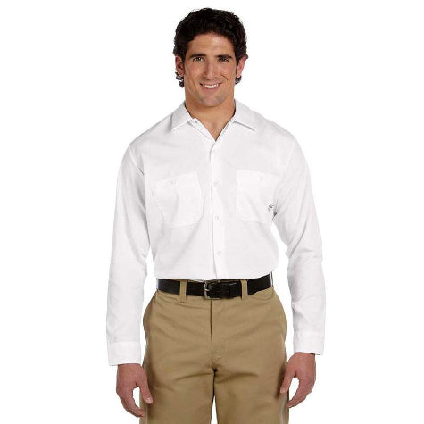 A man in a white custom Dickies work shirt and khakis standing in a room