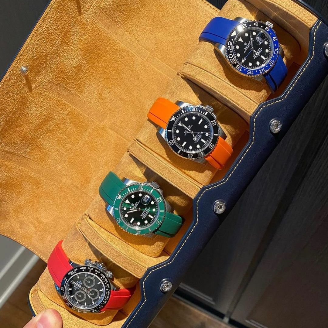 rolexes on rubber straps in a leather watch roll