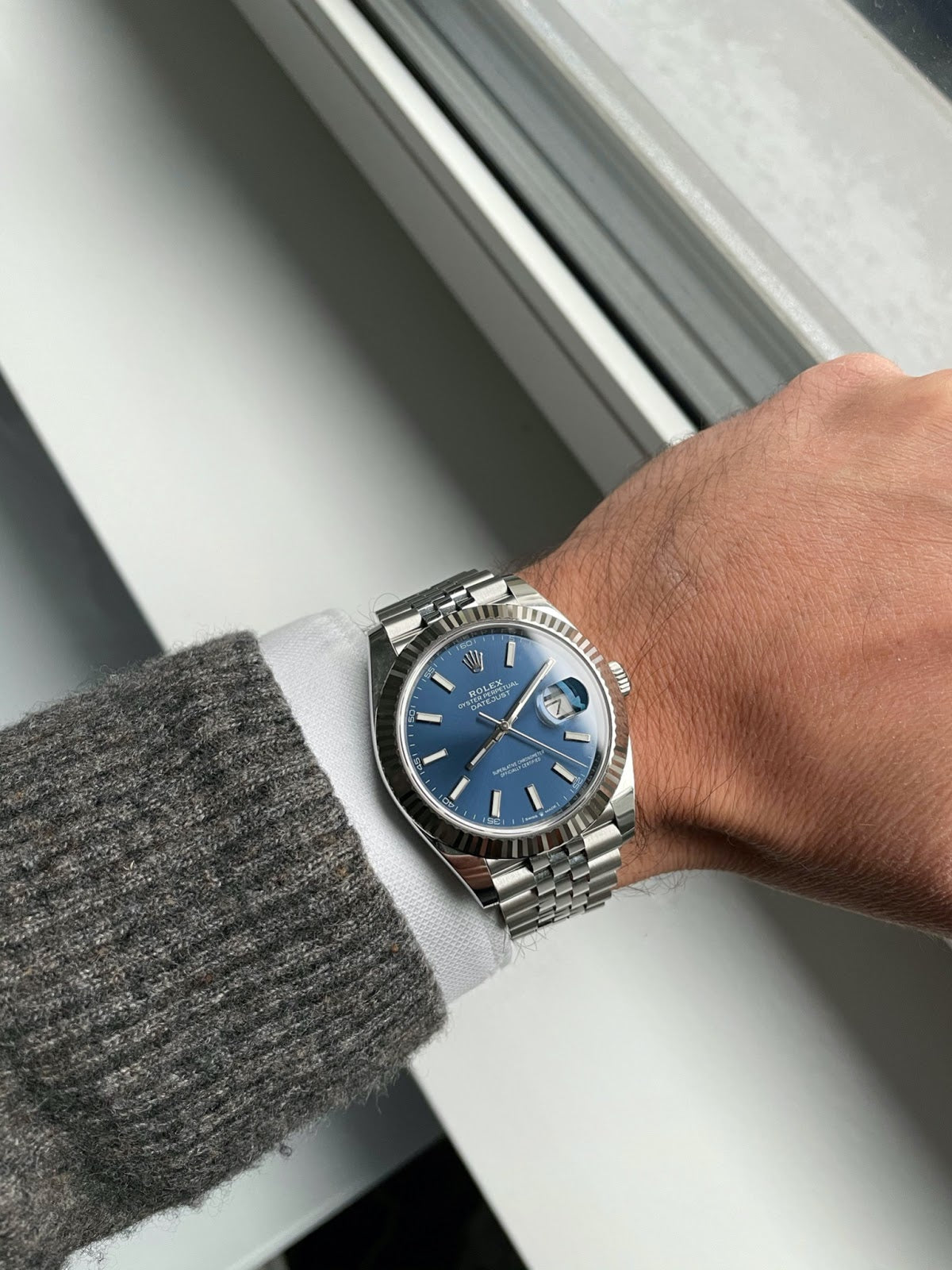 rolex datejust on with blue dial on wrist