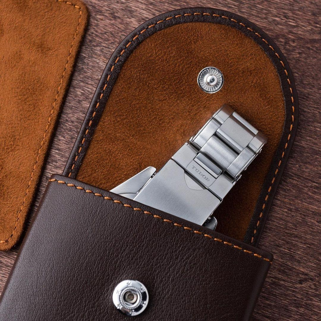 everest leather watch pouch with tudor bracelet peeking out