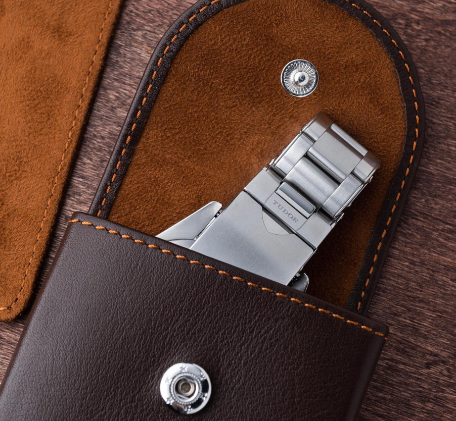 tudor watch peeking out of an everest leather watch pouch