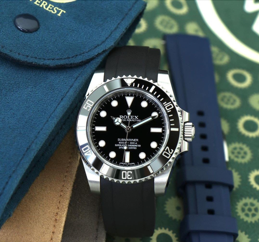 rolex submariner on black rubber strap as a graduation gift