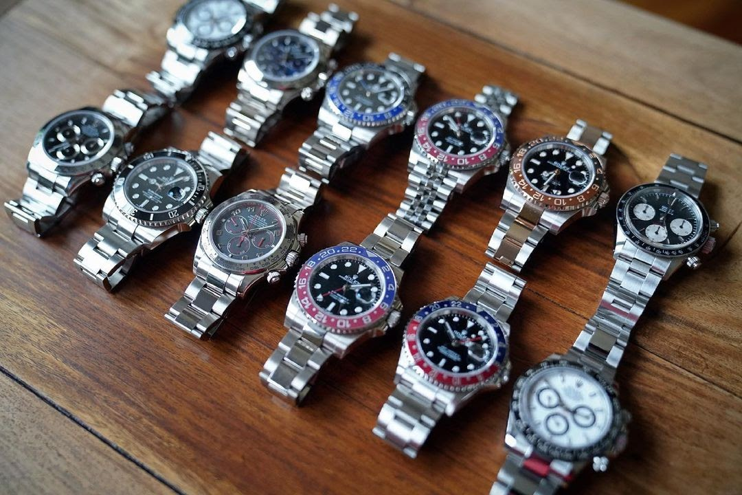 12 rolex watches sitting on a table