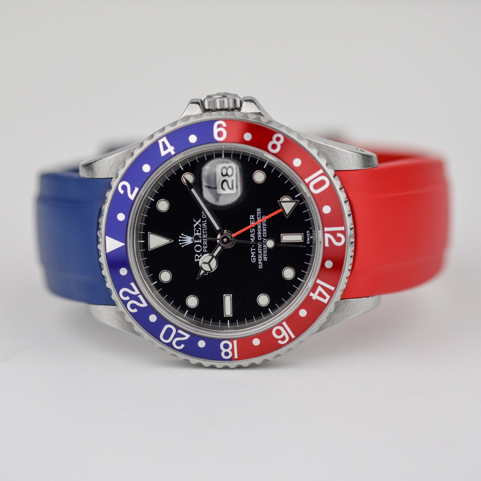 rolex pepsi with two rubber straps one red and one blue
