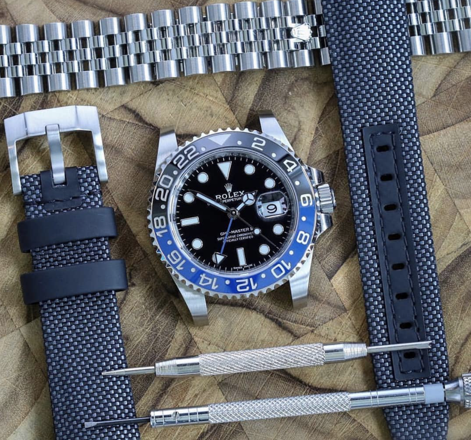 curved end nylon strap ready to install on a rolex gmt master II using tool kit