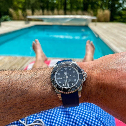 rolex on blue rubber by pool