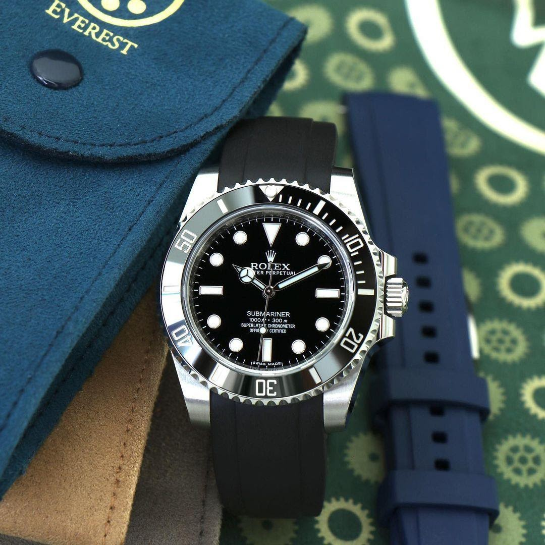 rolex submariner with a rubber strap and tang buckle