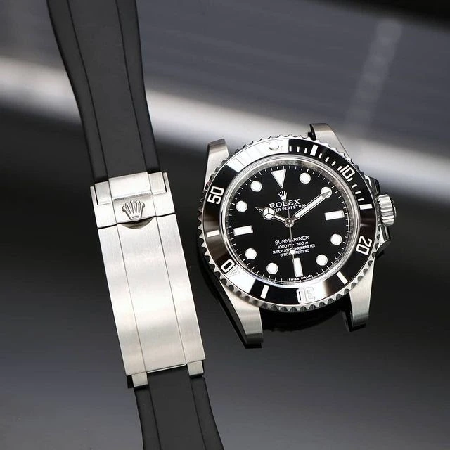 rolex submariner next to everest rubber deployant clasp rubber strap