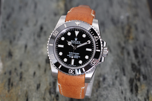 rolex submariner on curved end tan leather everest band