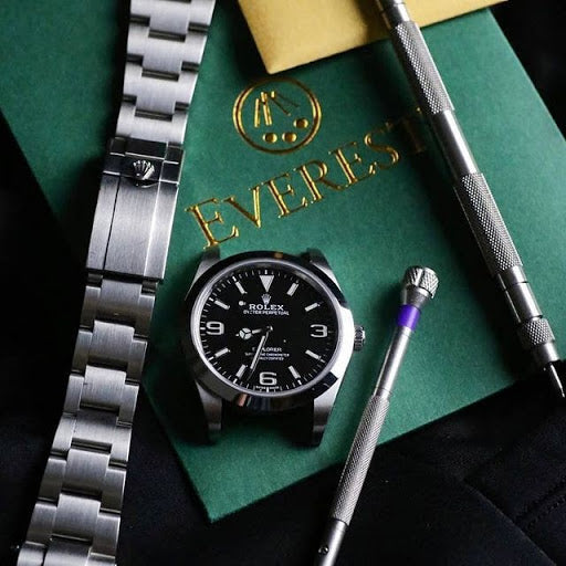 rolex watch disassembled with everest tool kit
