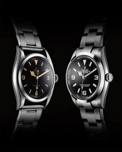 two rolexes facing each other