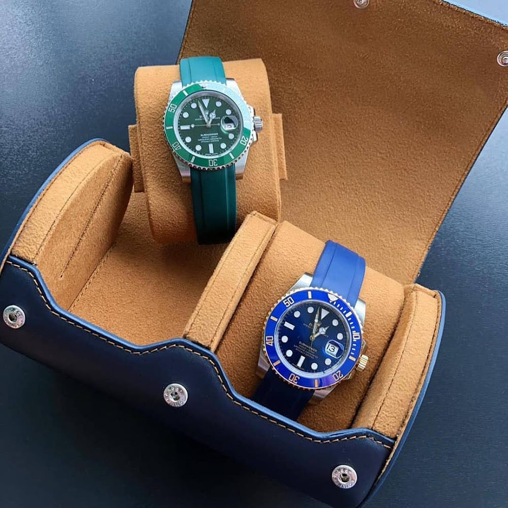 2 watch roll open with rolexes on rubber straps inside