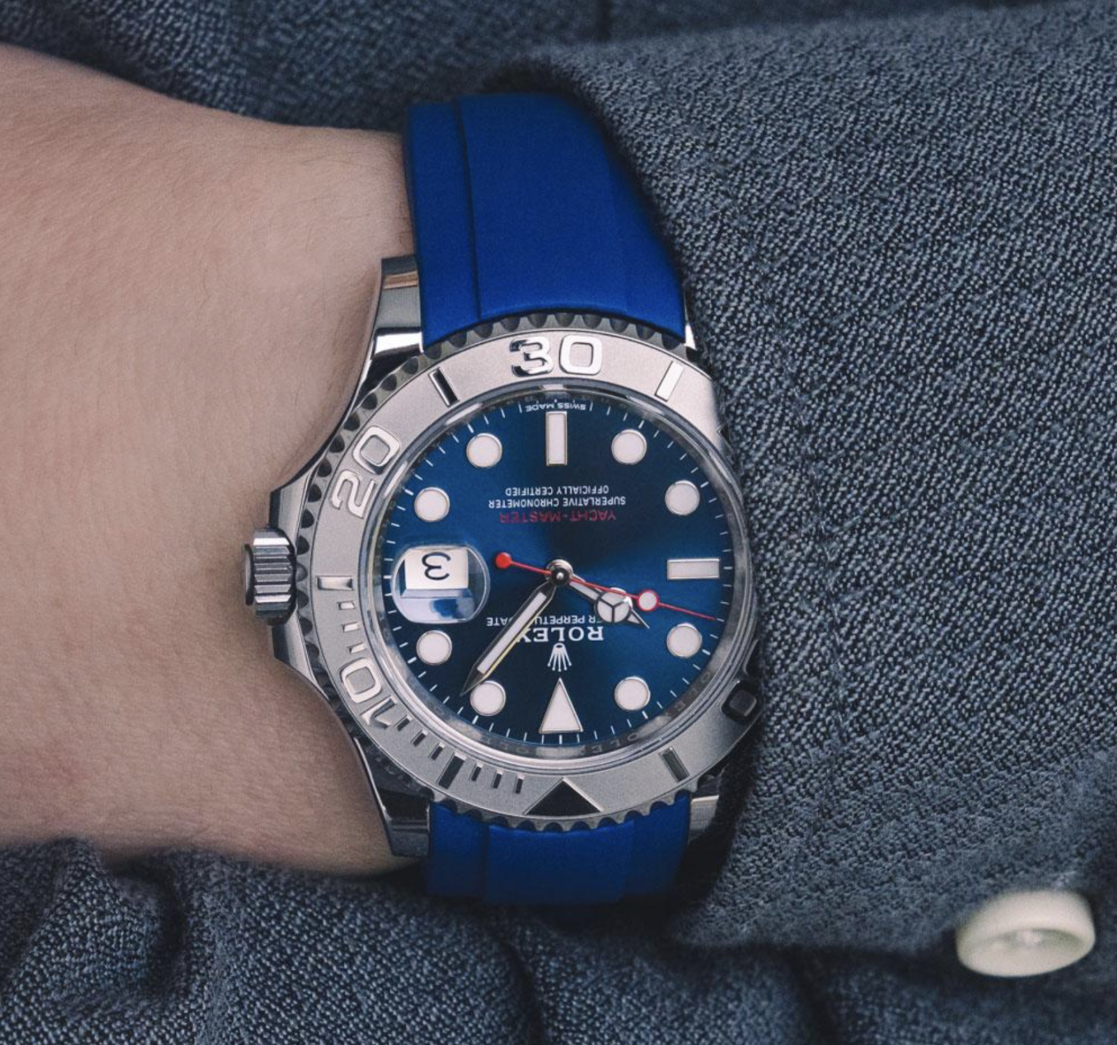 rolex yacht master on blue rubber