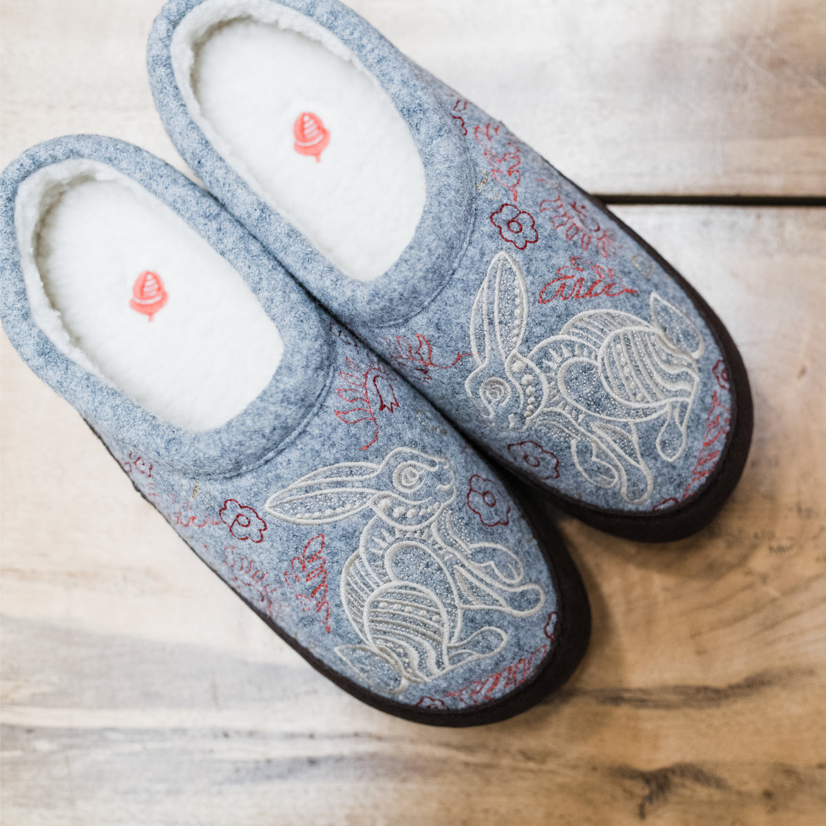Women's Forest Mule Slippers in Heather Grey Hare Right Angled View sitting on wood table