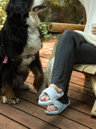 Women's Spa Slide Slippers in powder blue  with dog sitting on a deck
