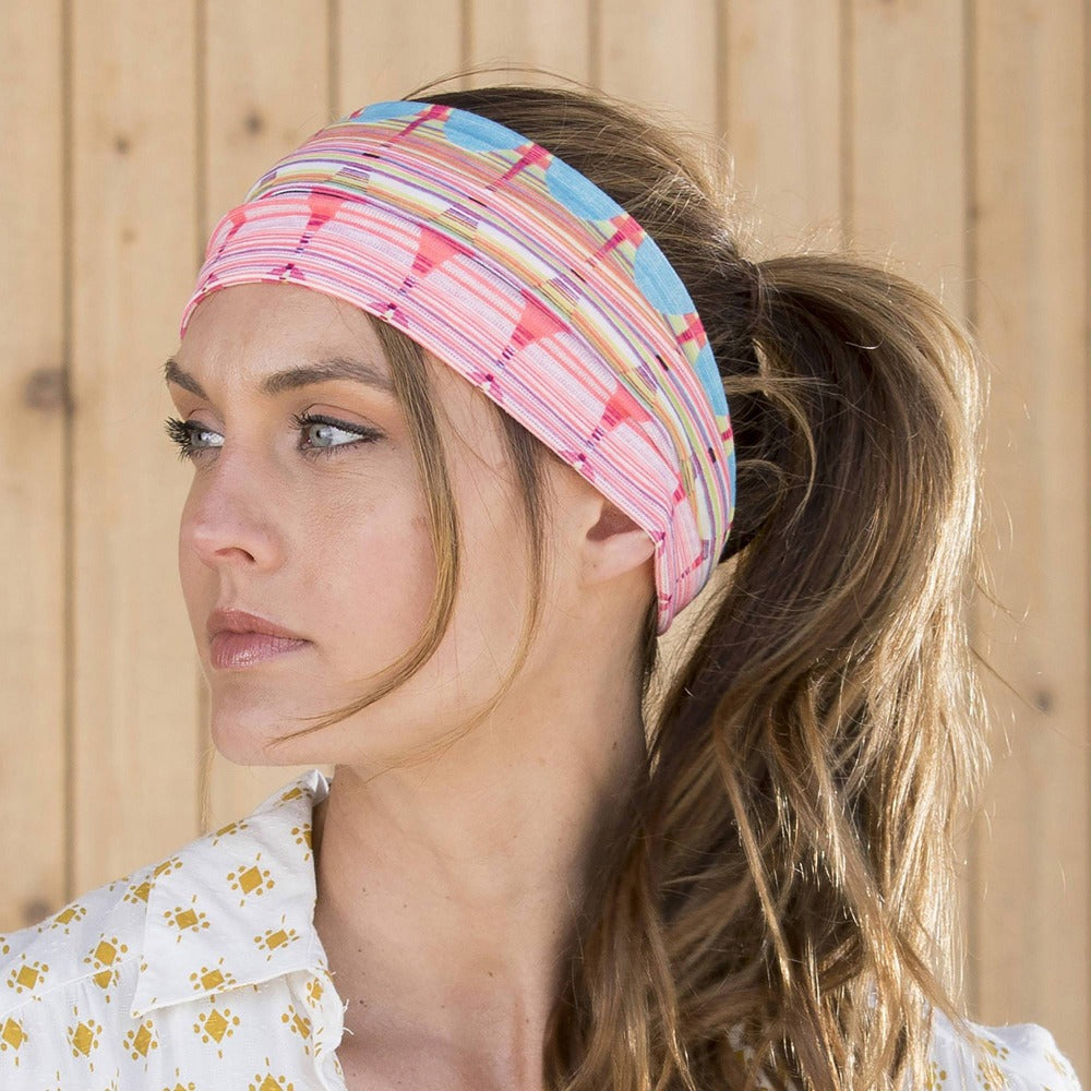 Lady wearing Pistil Edie Multi color jersey material headband in Persimmon