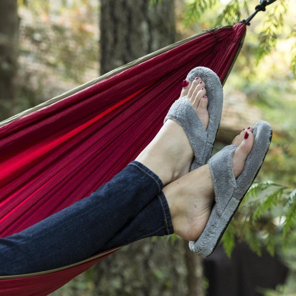 Women's Spa Thong Slippers in Grey On Model in Hammock