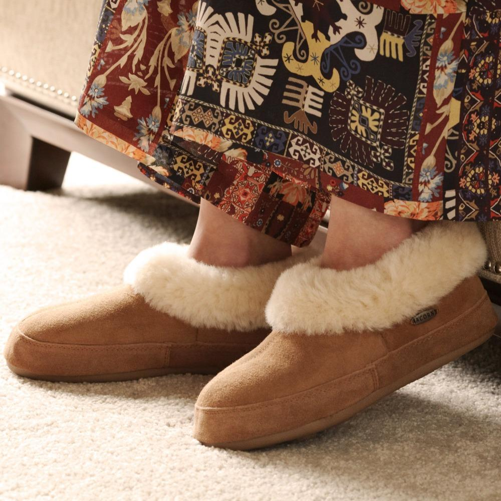 Women's Oh Ewe Boot Slippers on figure wearing boho skirt sitting on chair indoors