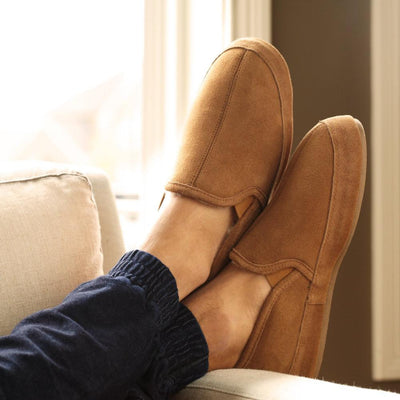 Men's Wool-Lined Romeo Slippers on figure kicking feet up off couch