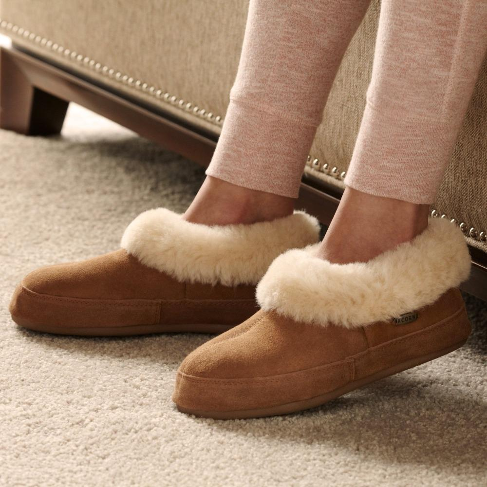 Women's Shearling Collar Slippers on figure sitting on couch inside with leggings on