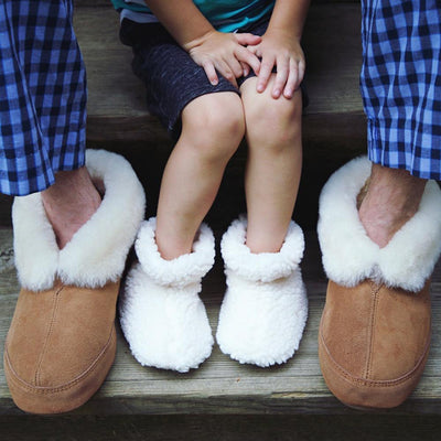 Toddler's Fuzzy Booties in Buff Popcorn on Model with Father in Ewe Collar Slippers