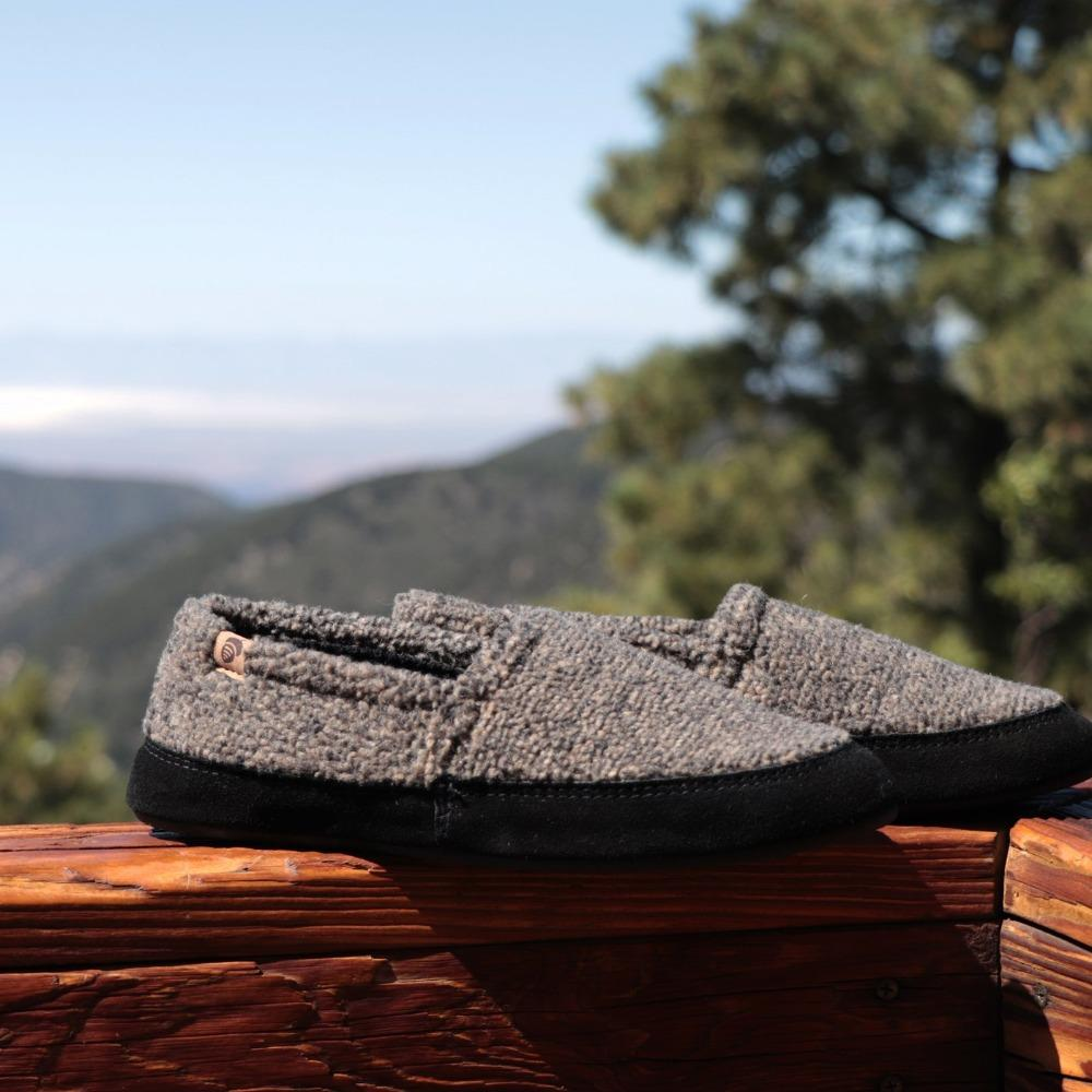 Men's Original Acorn Moccasins in Earth Tex On Wood  in Front of Mountain