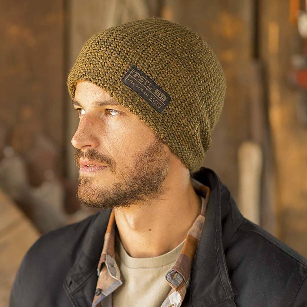 Gentleman wearing Pistil Franco Chunky Knit Beanie in Tobacco