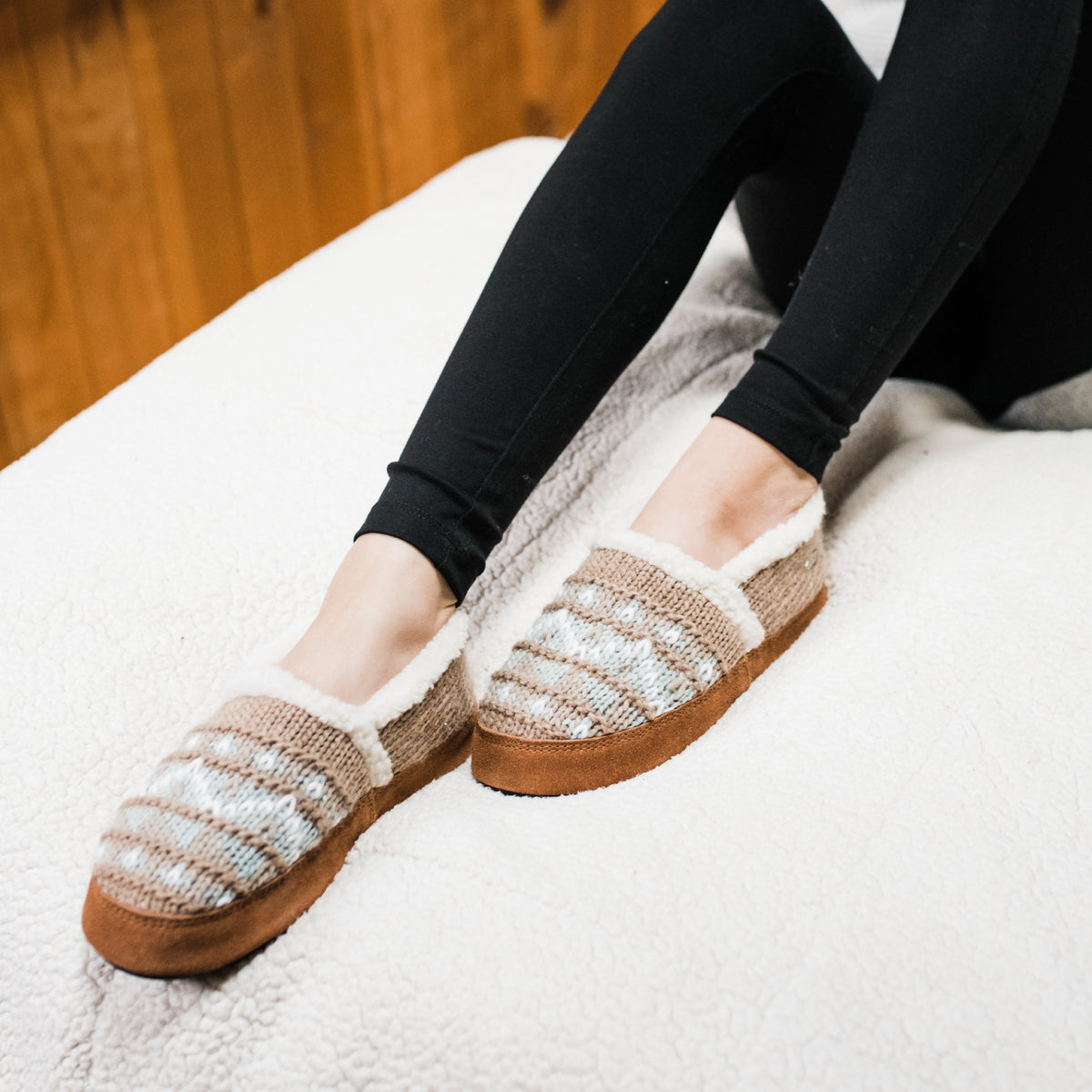 Nordic Oatmeal Heather Acorn Slipper on a white blanket