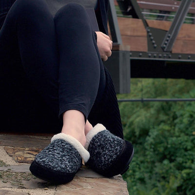 Women's Jam Mule Slippers on figure sitting on ledge of rock by train tracks