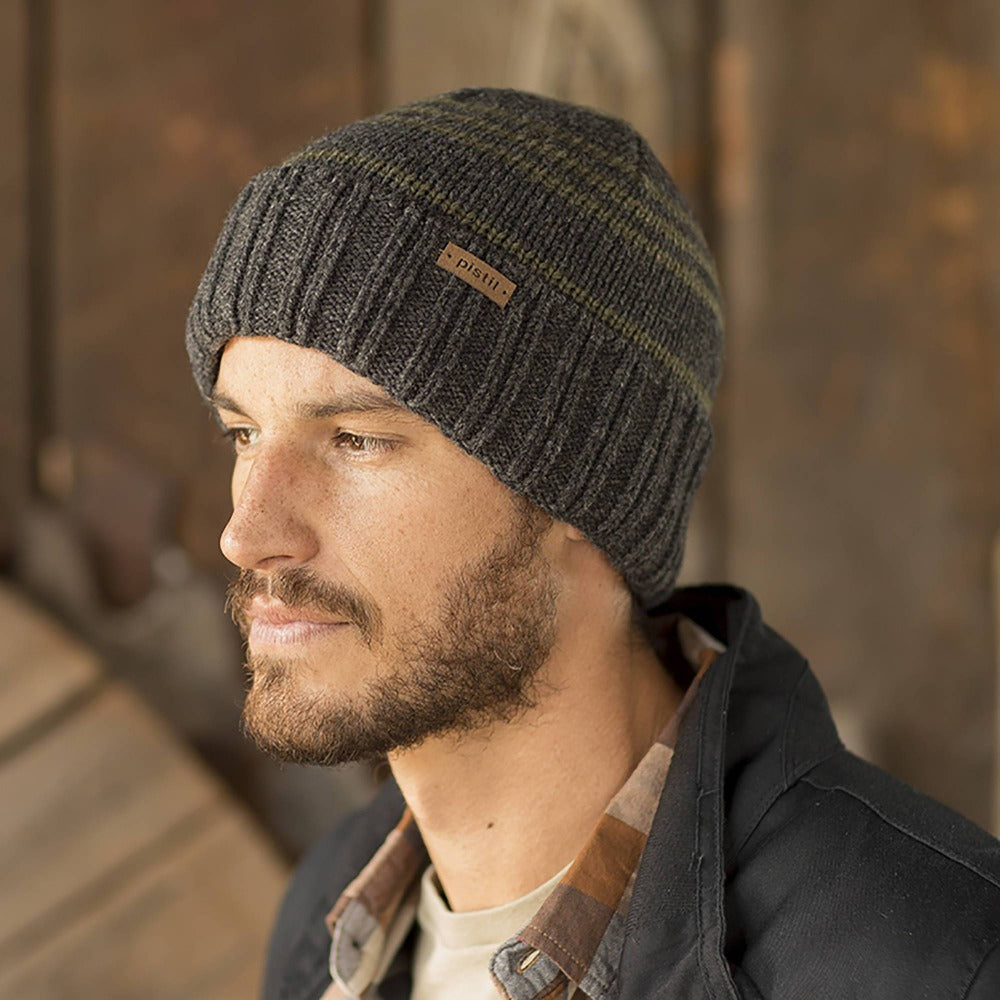 Gentleman wearing Pistil Perch Knit Beanie with grey band and green stripes