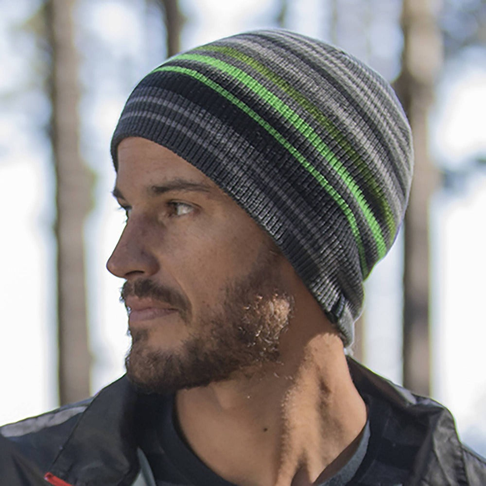 Gentleman wearing Pistil Gordy Slouchy Knit Beanie with grey and black stripes with a few green stripes