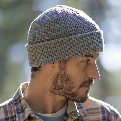 Gentleman wearing Pistil Tinh Beanie with waffle knit in Grey