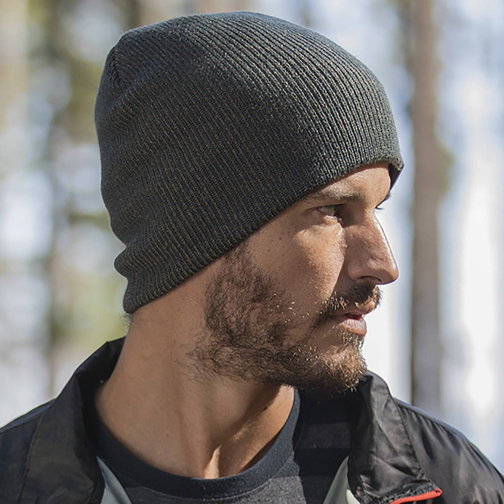 Gentleman wearing Pistil Chico Slouch Knit Beanie in Spruce