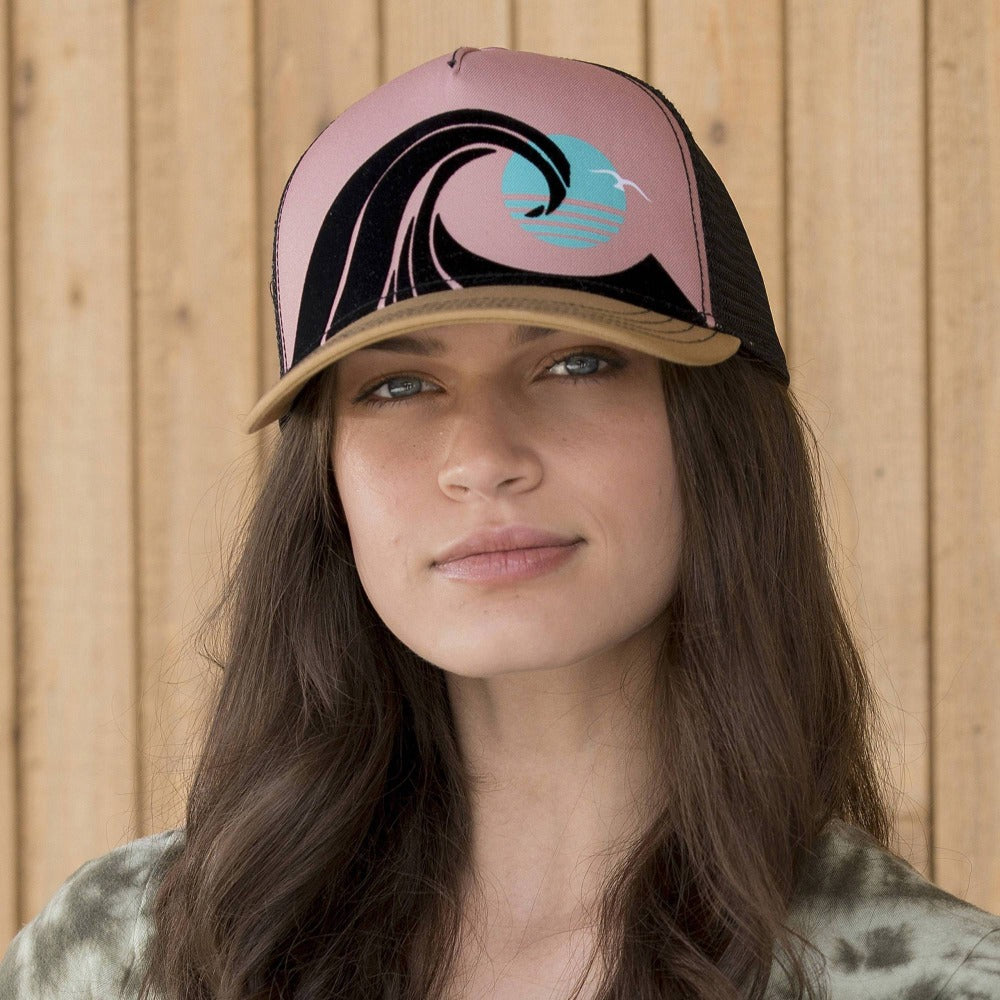 Lady wearing Pistil Wedge Trucker Hat with colorful ocean wave on front panel in Black